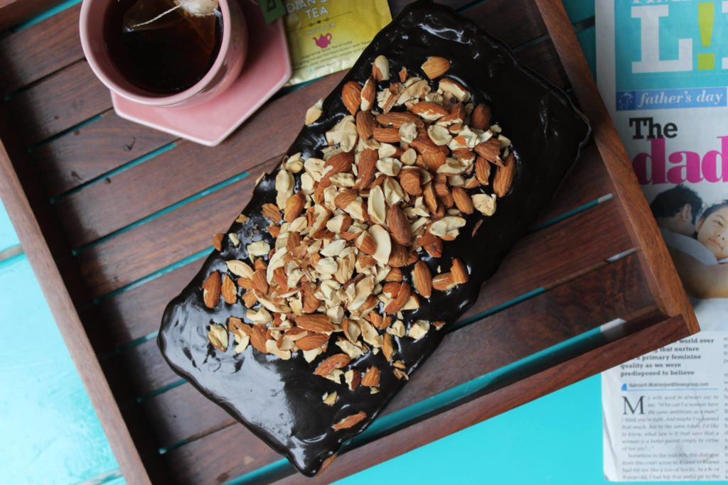 Almond Loaf Cake with Chocolate Glaze and Toasted Almonds