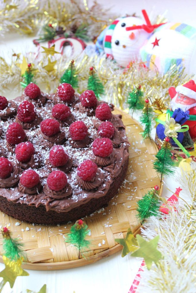 Eggless Dark chocolate cake, chocolate buttercream frosting and fresh raspberries
