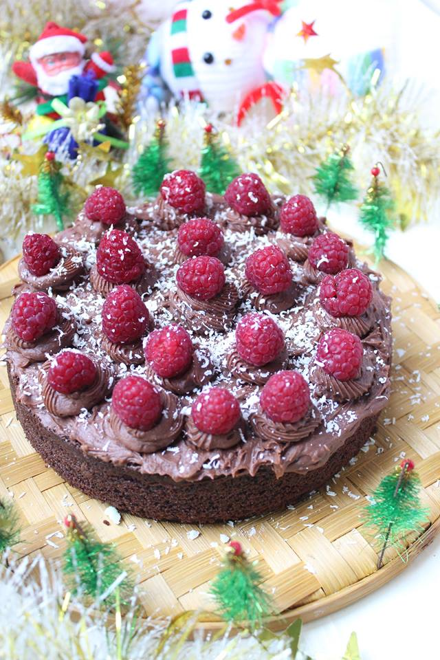 Rich dark chocolate cake with chocolate buttercream and fresh raspberries