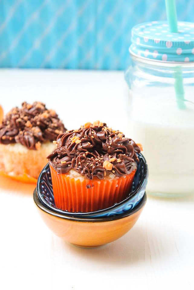 Buttery soft eggless orange cupcake with chocolate buttercream frosting